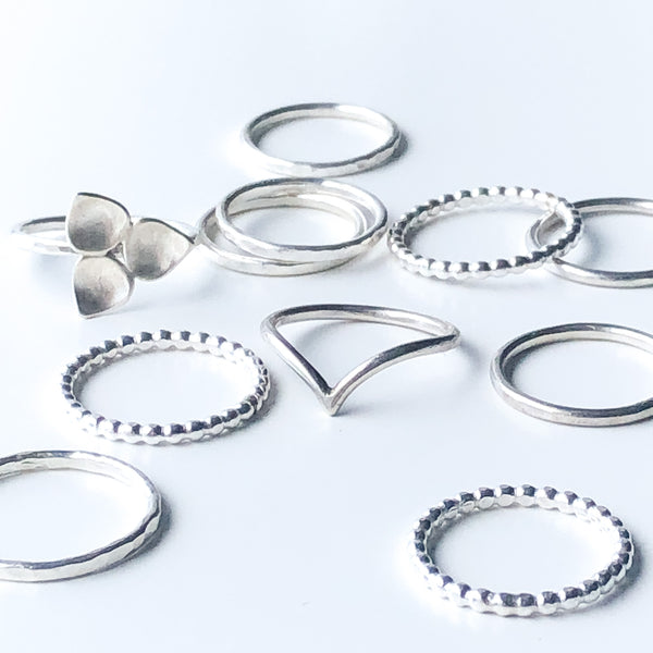 A grouping of silver stacking rings