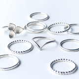 a group of different styles of stacking rings