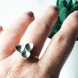Silver trillium ring on a finger