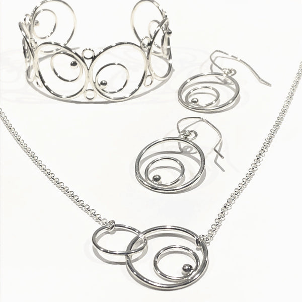 silver circles link necklace, earrings, and cuff bracelet
