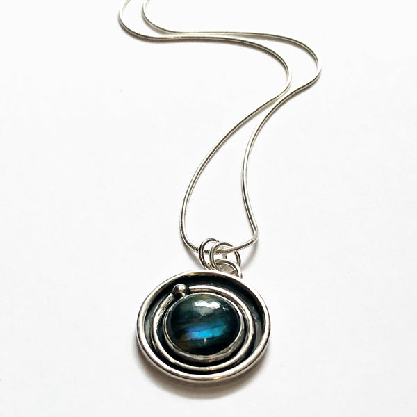 Silver necklace with a blue stone