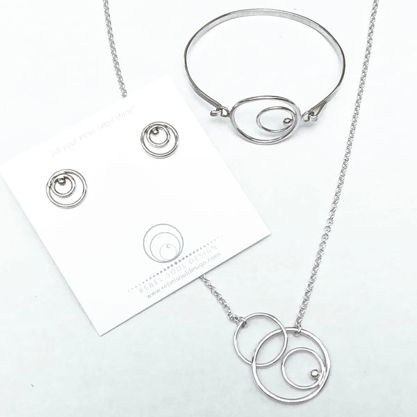 Silver circles stud earrings with coordinating necklace and bracelet