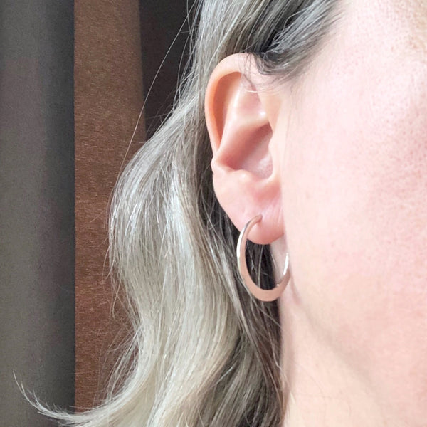 Small silver modern boho hoops on model