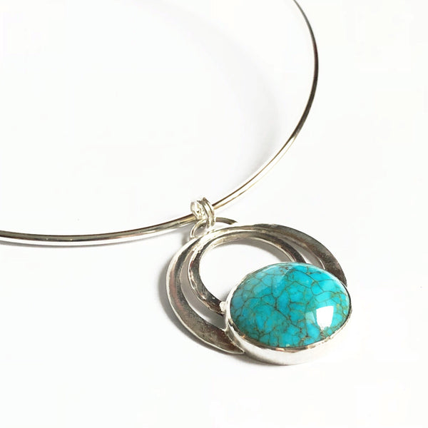 close up view of turquoise contemporary pendant