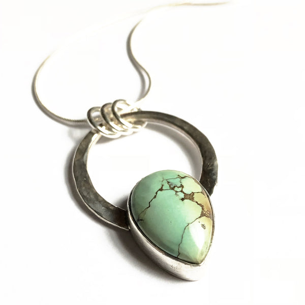 Small silver and treasure mountain turquoise pendant