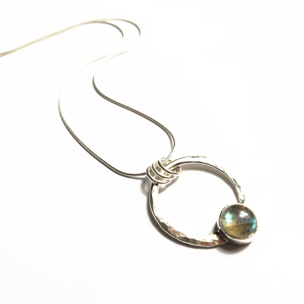 Silver and labradorite encircled pendant