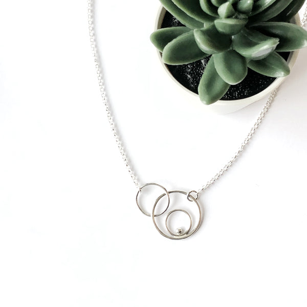 Silver orbital linked circles necklace