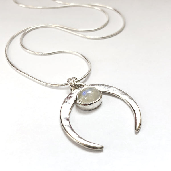 Oval moonstone bezel set in a naja inspired pendant