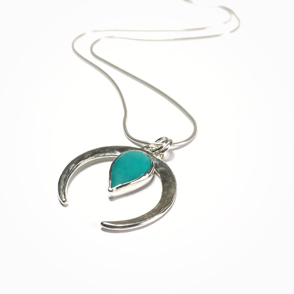 Sterling silver and teardrop shaped turquoise gemstone crescent shaped pendant