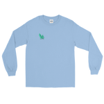 "Light blue long sleeve tee with several angled emerald shards of variable shadowing and a caption saying ""Vibrant at the Highest Frequency Possible"" below the crystal all located on the top right breast of the shirt"