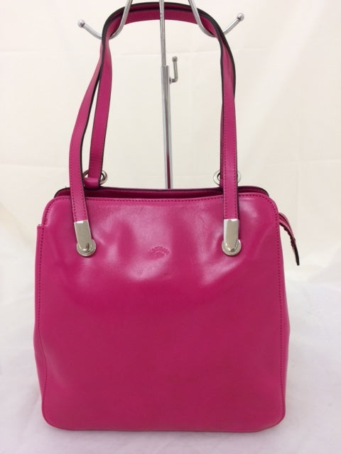 Leather handbag which converts to backpack