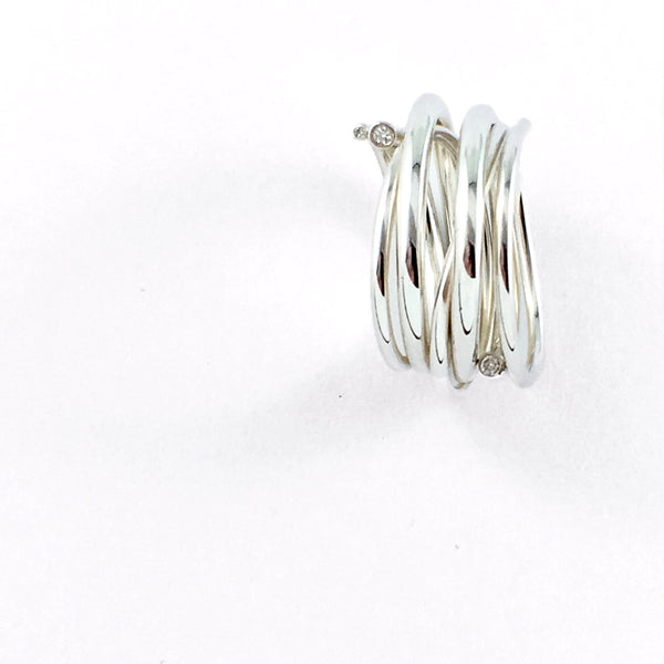 No two Entangled Rings are the same. Handmade in solid Sterling Silver and set with 4 diamonds at the ends of each tendril. Fluid, freeform ribbons of silver will wrap around your finger and delight with every diamond shimmer.