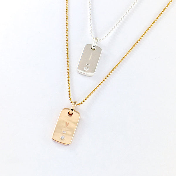 The Oneness Pendant, customise and make it your own! Handmade in solid 9ct Gold or Sterling Silver with a matching ball chain. Set with 2 diamonds and personalised with your initial. Or keep it totally plain.