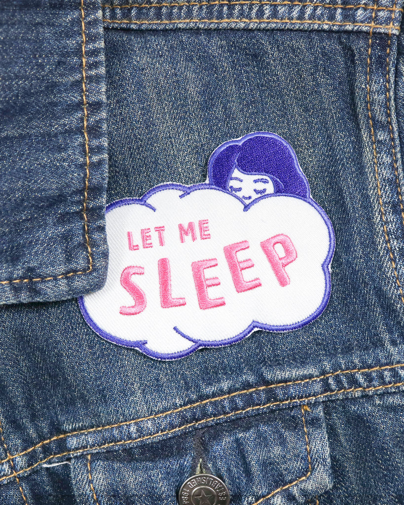 Image of Let Me Sleep Iron-On Patch applied to denim jacket