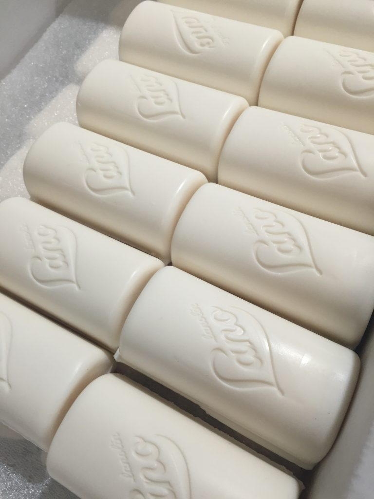 Lanolin egg white and goats milk cleansing bars lined up in production line