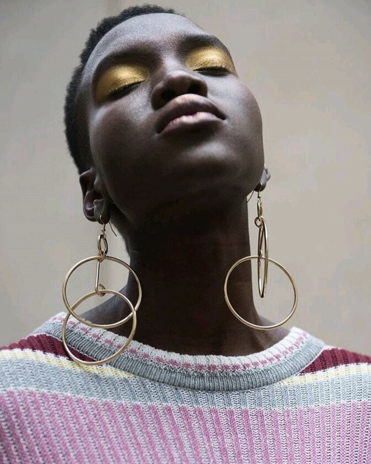 Bronze eyeshadow and long earrings