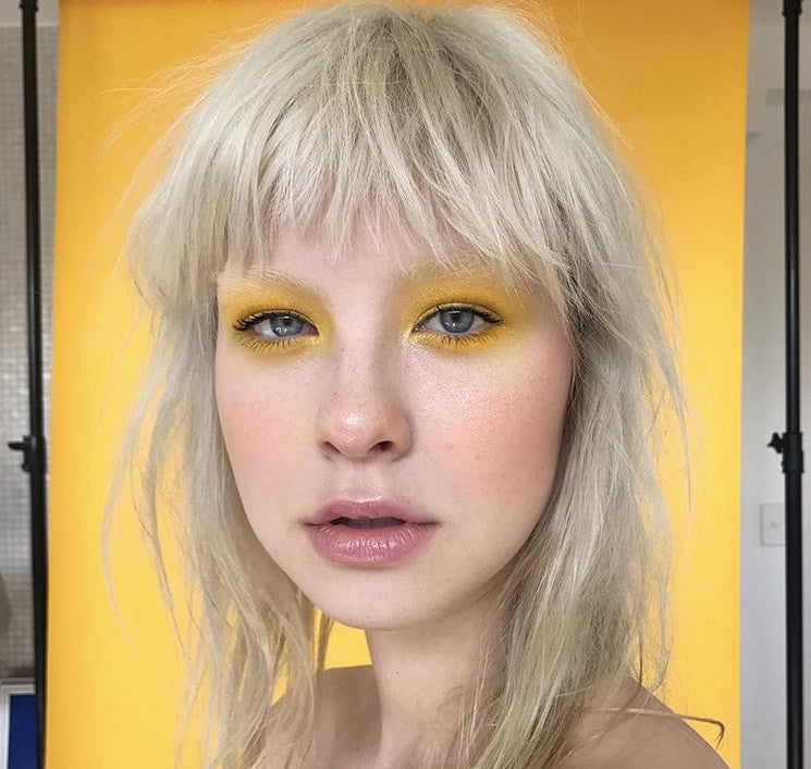 Blonde with yellow eye and yellow backdrop