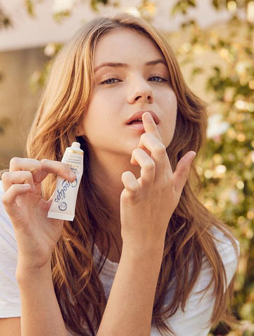 applying 101 Ointment to lips for extreme natural hydration