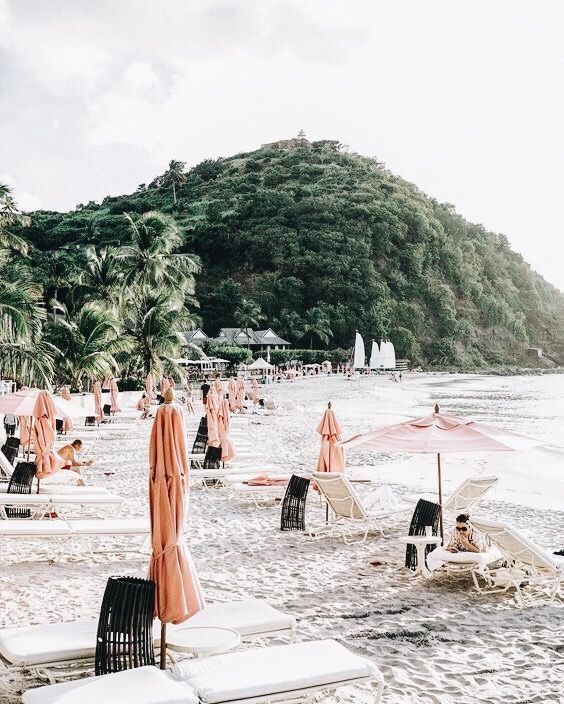 Blush pink beach umbrellas
