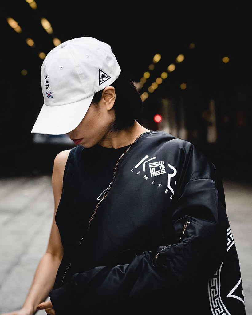 1 Million Dance Studio chief choreographer Lia Kim in KORE x GACHI dad hat and KORE x GACHI bomber jacket.