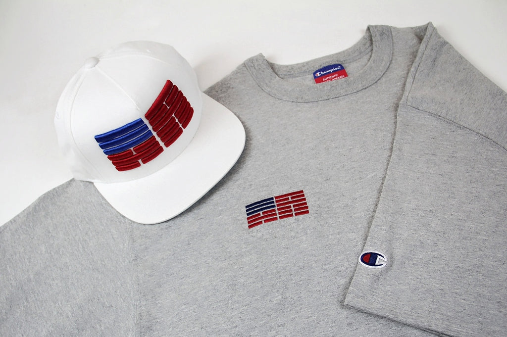 Korelimited's Korean American Flag snapback in white sitting over the heather grey KR-AM Champion jersey tee.