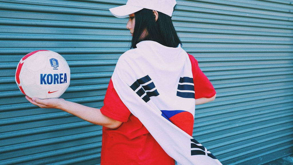 Model with small Korean Flag and soccer ball.