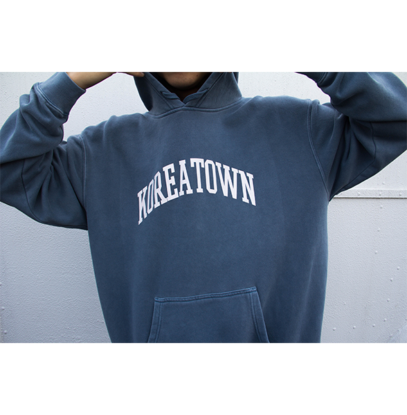 Front shot of our model wearing Koreatown LA washed slate hoodie.