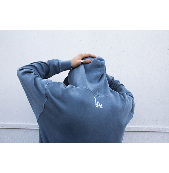 Back shot of our model wearing Koreatown LA washed slate hoodie.