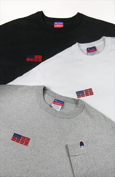 Black, heather grey, and white KR-AM Champion jersey tee laid out stacked.