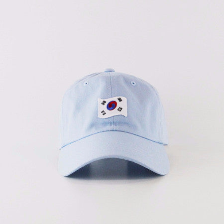 Front view of light blue dad hat with 1882 Korean flag embroidery patch on the center.