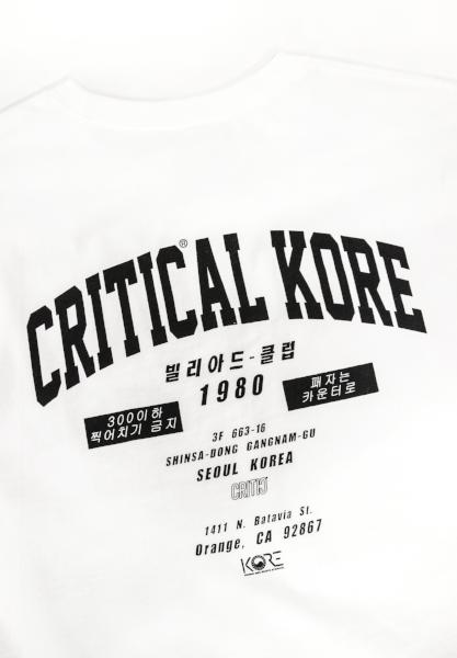 Detailed view of the back Critical KORE print on white Champion tee. KORE - Keepin Our Roots Eternal