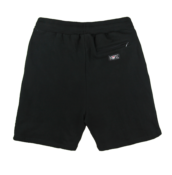 Back view of black shorts with KORE logo printed on the bottom.