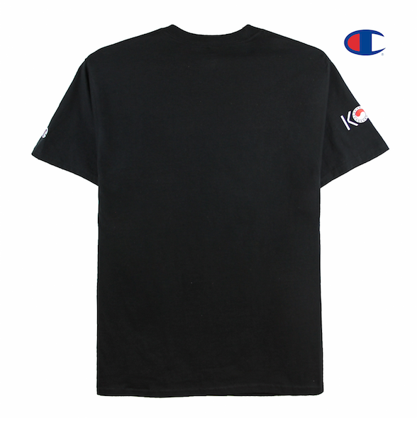 Back view of black Champion tee with Keepin Our Roots Eternal printed on the front and KORE logo printed on the sleeve.