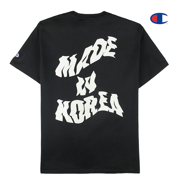 Back view of black tee with made in korea printed on the back and taegeuk printed on the front.