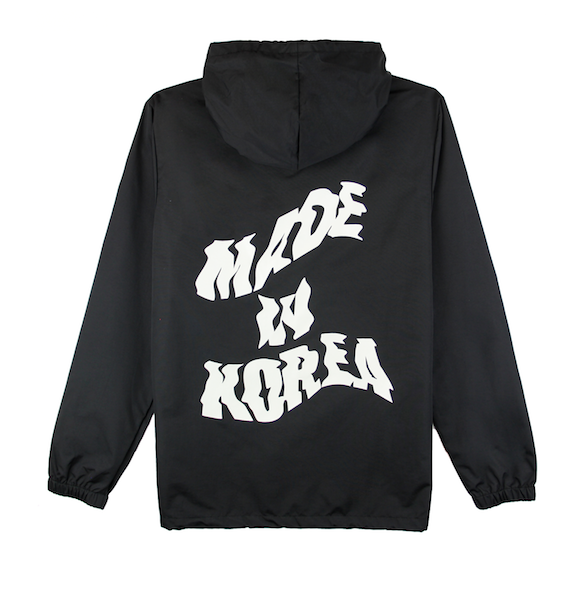Back view of black jacket with made in korea printed on the back and taegeuk printed on the front.