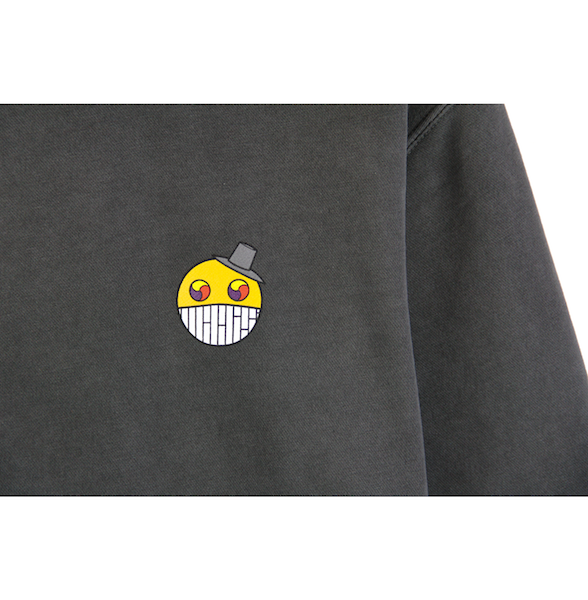 Detailed view of black ComfortWash crewneck with cartoon character design on the chest.