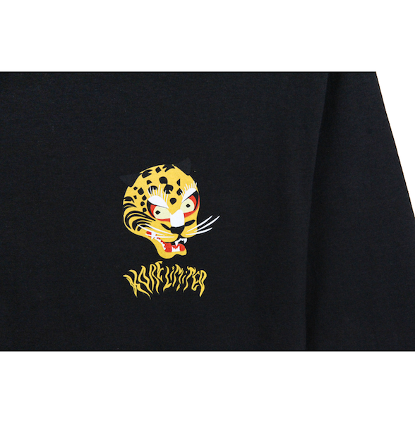 Close up view of black long sleeve with a graphic illustration of the Korean tiger's head and KORELIMITED printed underneath it. KORE Limited - Keepin Our Roots Eternal