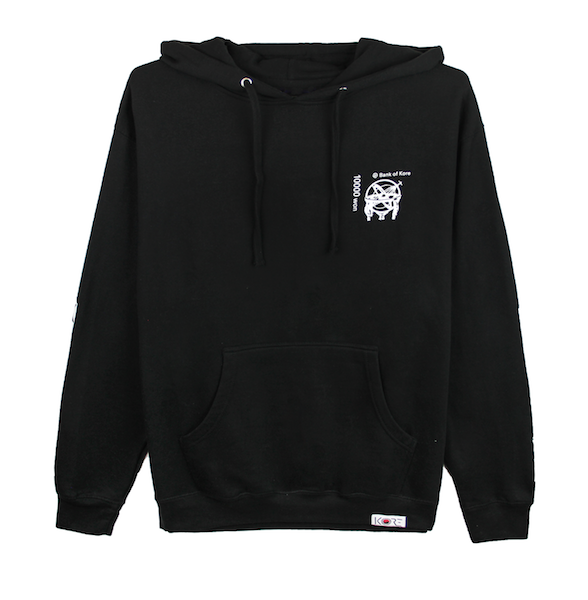 Back view of black pullover hoodie with centered white Won symbol on the Korean 10,000 won bill. KORE Limited - Keepin Our Roots Eternal
