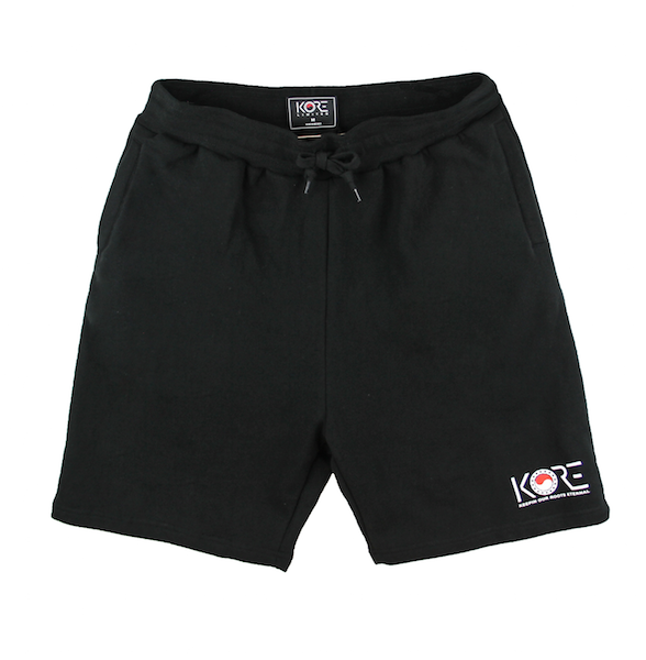 Front view of black shorts with KORE logo printed on the bottom.