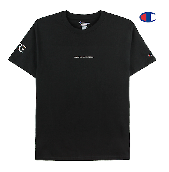 Front view of black Champion tee with Keepin Our Roots Eternal printed on the front and KORE logo printed on the sleeve.