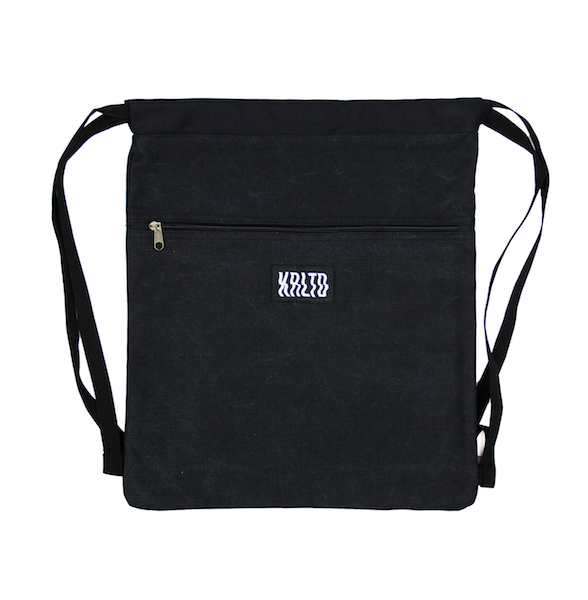 Front view of black drawstring canvas bag with KRLTD embroidered below zipper.
