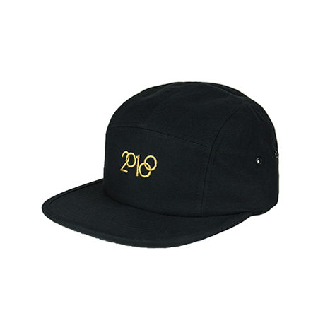 Front view of gold 2018 embroidery on a black jockey cap. KORE - Keepin Our Roots Eternal