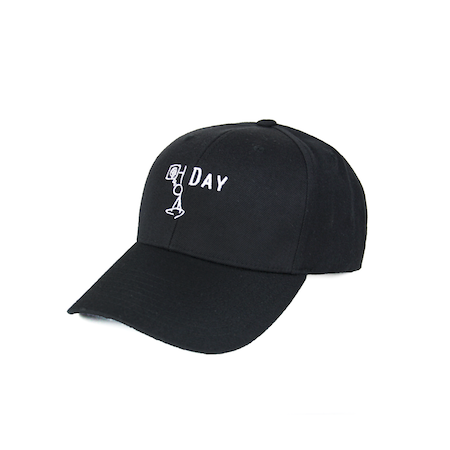 Side view of black curved visor cap with a mungday graphic embroidered on the front.