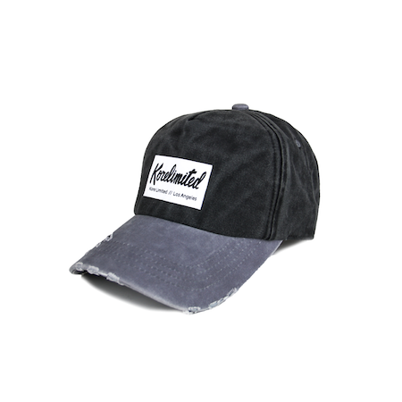 Side view of black with grey bill Korelimited washed dad hat with Korelimited patch on the front.
