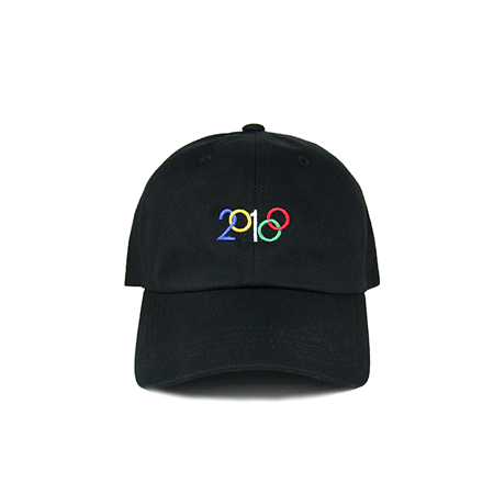 Front view of 2018 and Olympic rings embroidered on a black dad hat. KORE - Keepin Our Roots Eternal