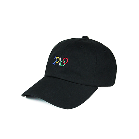 Side view of 2018 and Olympic rings embroidered on a black dad hat. KORE - Keepin Our Roots Eternal