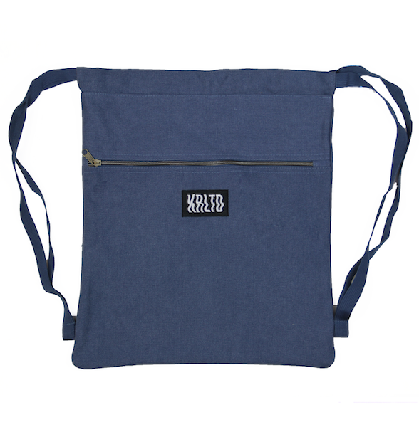 Front view of navy drawstring canvas bag with KRLTD embroidered below zipper.