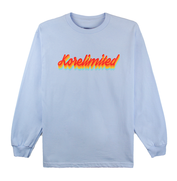 Front view of powder blue long sleeve with Rainbow design printed in the front.