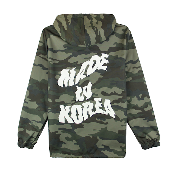 Back view of camo jacket with made in korea printed on the back and taegeuk printed on the front.