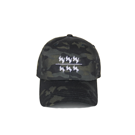 Front view of won over dollars embroidered on a camo dad hat.